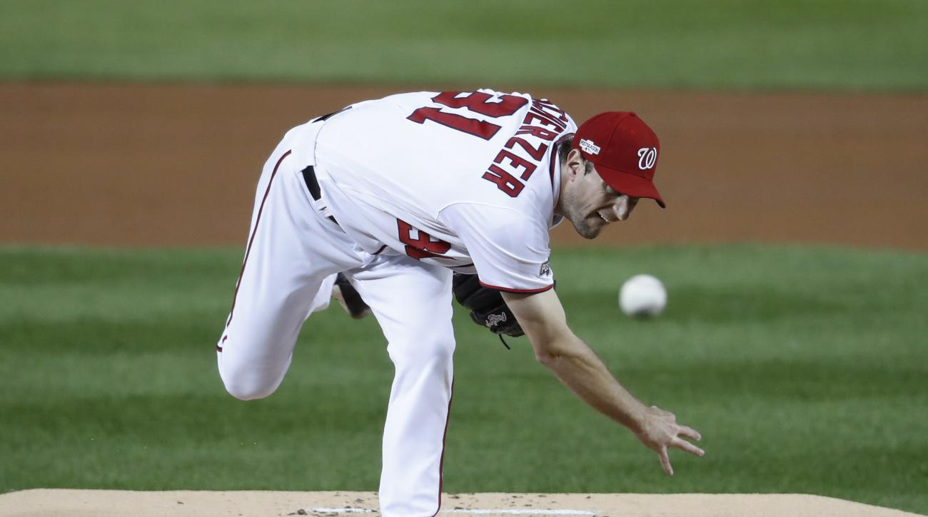 Washington Nationals starting pitcher Max Scherzer throws to a Los Angeles Dodgers batter during the first inning of Game 5 of baseball's National League Division Series, at Nationals Park, Thursday, Oct. 13, 2016, in Washington. (AP Photo/Alex Brandon, P