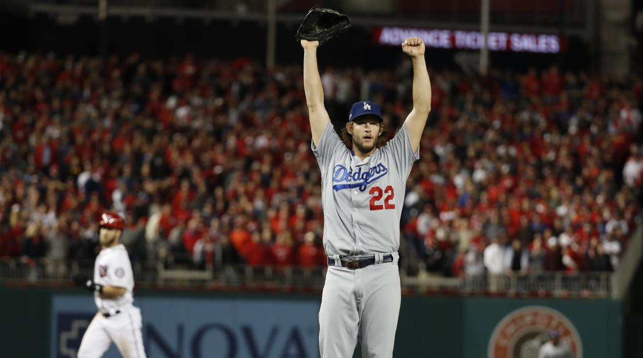 Los Angeles Dodgers pitcher Clayton Kershaw (22) celebrates striking out Washington Nationals' Wilmer Difo for the final out of Game 5 of a baseball National League Division Series, at Nationals Park early Friday, Oct. 14, 2016, in Washington. The Dodgers