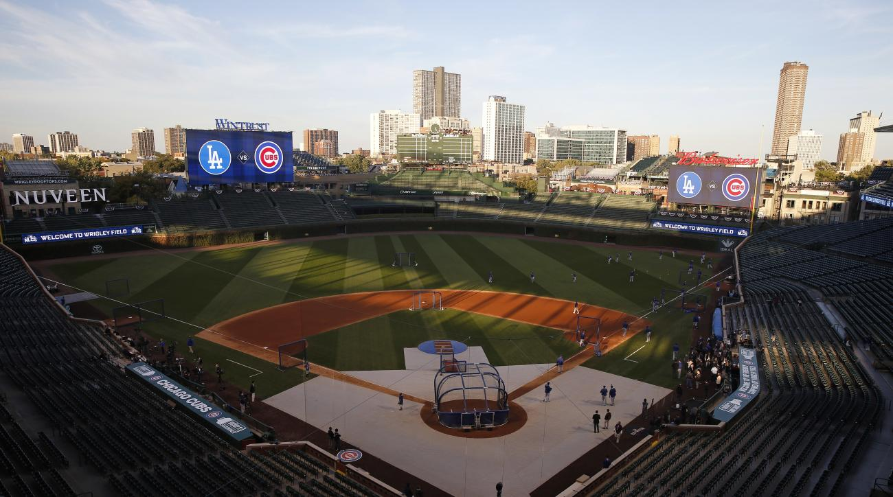 Los Angeles Dodgers players work out during the team practice at Wrigley Field before baseball's National League Championship Series against the Chicago Cubs, Friday, Oct. 14, 2016, in Chicago. The Dodgers play Game 1 of the series against the Cubs on Sat