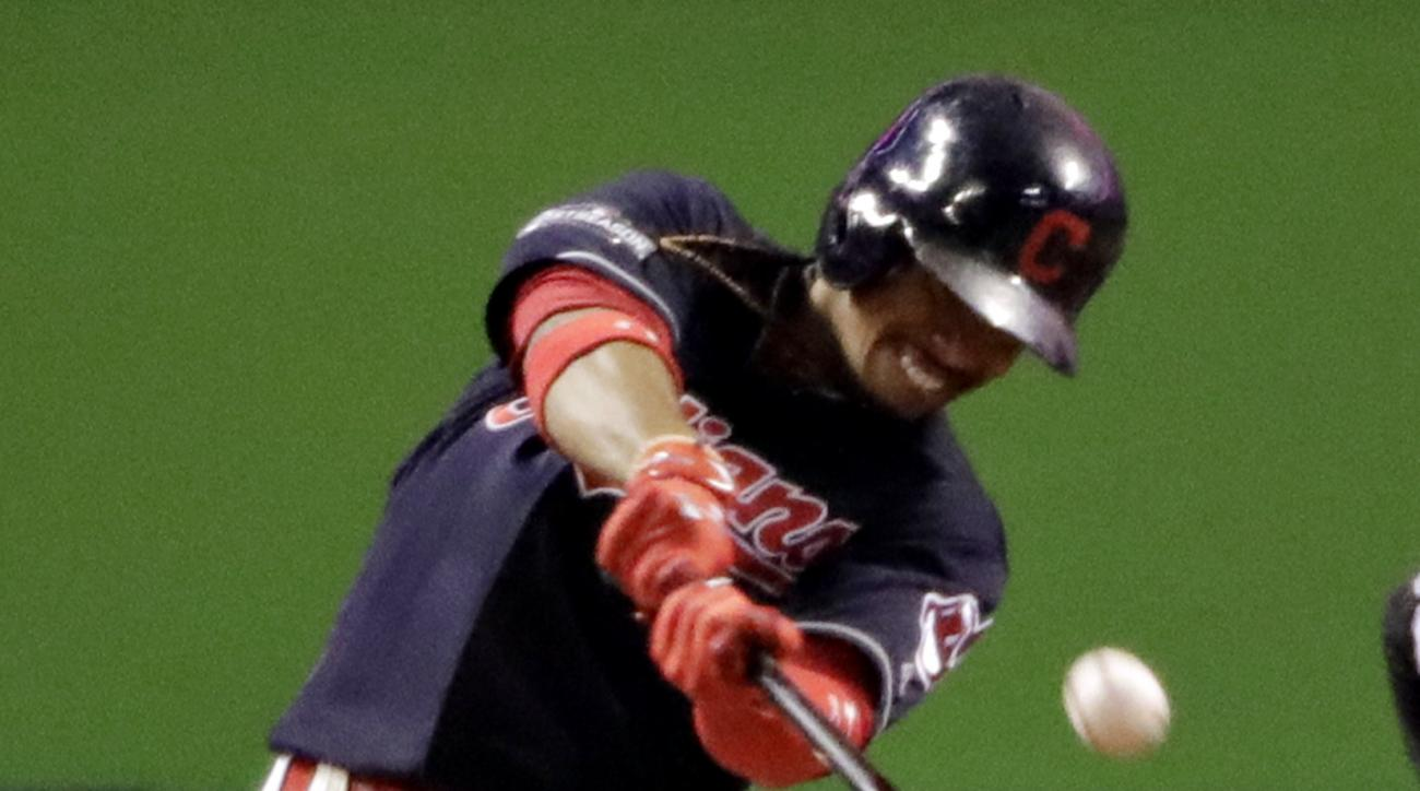 Cleveland Indians' Francisco Lindor hits a two-run home run against the Toronto Blue Jays during the sixth inning in Game 1 of baseball's American League Championship Series in Cleveland, Friday, Oct. 14, 2016. (AP Photo/Charlie Riedel)