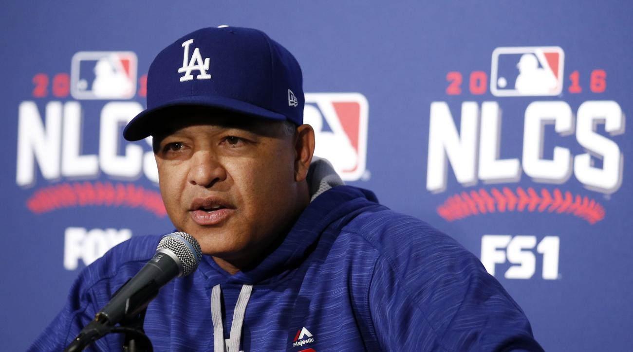 Los Angeles Dodgers manager Dave Roberts answers a questions during a news conference before Game 1 of baseball's National League Championship Series against the Chicago Cubs, Saturday, Oct. 15, 2016, in Chicago. (AP Photo/Nam Y. Huh)