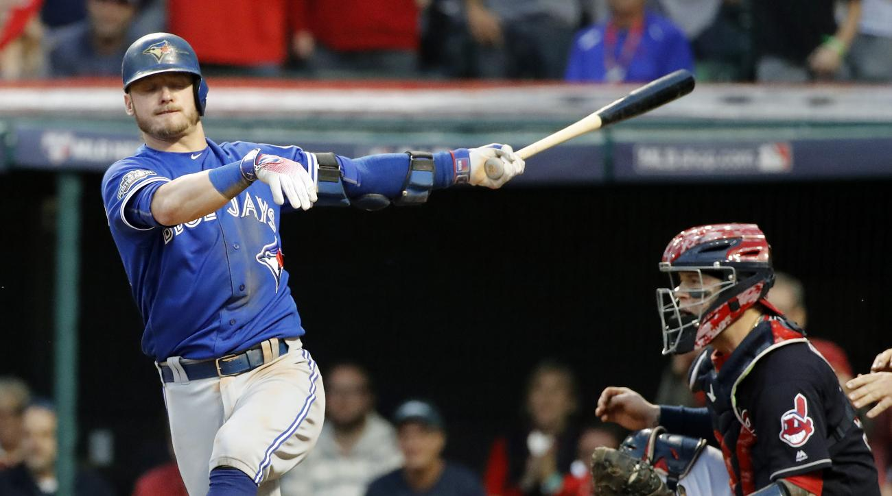 Toronto Blue Jays' Josh Donaldson strikes out against the Cleveland Indians during the eighth inning in Game 2 of baseball's American League Championship Series in Cleveland, Saturday, Oct. 15, 2016. (AP Photo/Gene J. Puskar)