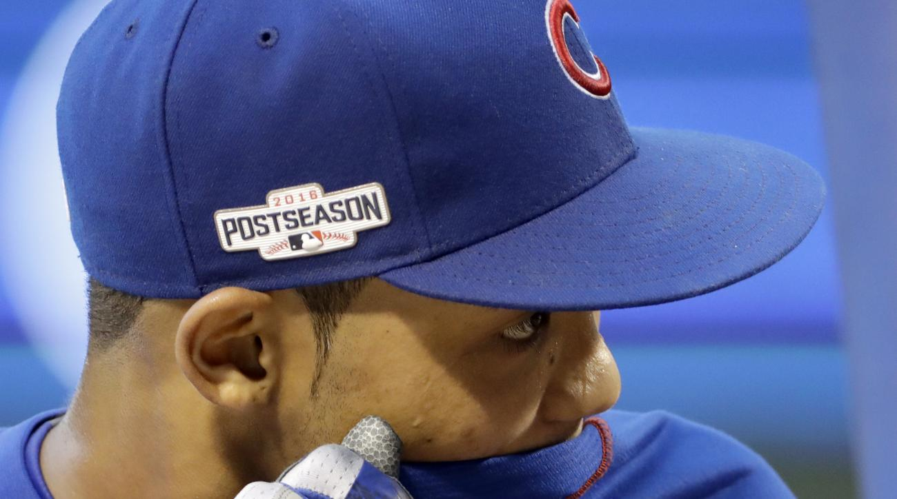 Chicago Cubs shortstop Addison Russell wipes his sweat during batting practice before Game 2 of the National League baseball championship series against the Los Angeles Dodgers Sunday, Oct. 16, 2016, in Chicago. (AP Photo/David J. Phillip)