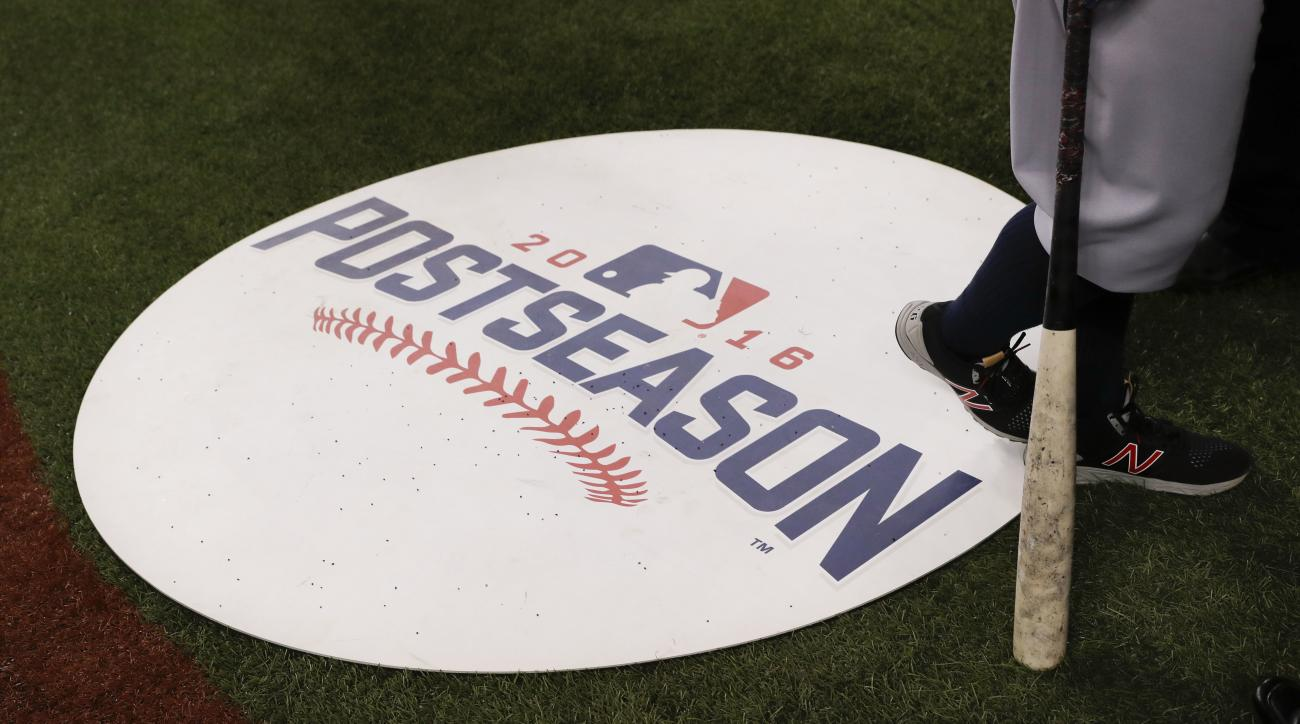 Cleveland Indians first baseman Mike Napoli stands on the on deck circle during batting practice before Game 3 of baseball's American League Championship Series against the Toronto Blue Jays in Toronto, Monday, Oct. 17, 2016. (AP Photo/Charlie Riedel)