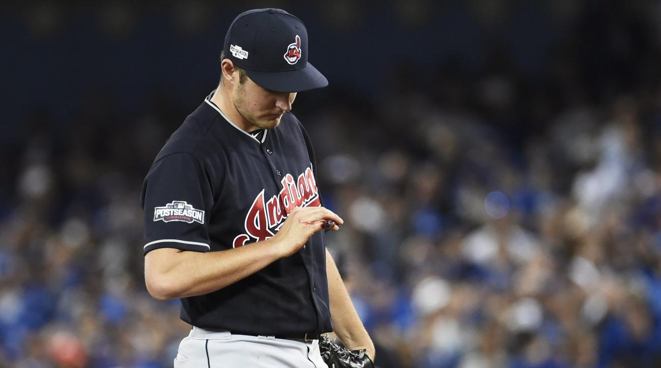 Cleveland Indians starting pitcher Trevor Bauer (47) looks at his bleeding finger during first inning of game three American League Championship Series baseball action against the Toronto Blue Jays in Toronto on Monday, Oct. 17, 2016. (Nathan Denette/The
