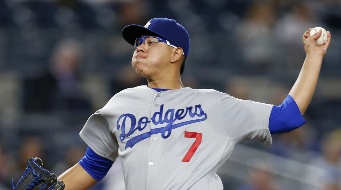 FILE - This Sept. 13, 2016 file photo shows Los Angeles Dodgers' starting pitcher Julio Urias delivering during the first inning of a baseball game against the New York Mets in New York. Urias is scheduled to start for the Dodgers in Game 4 of the NL Cham