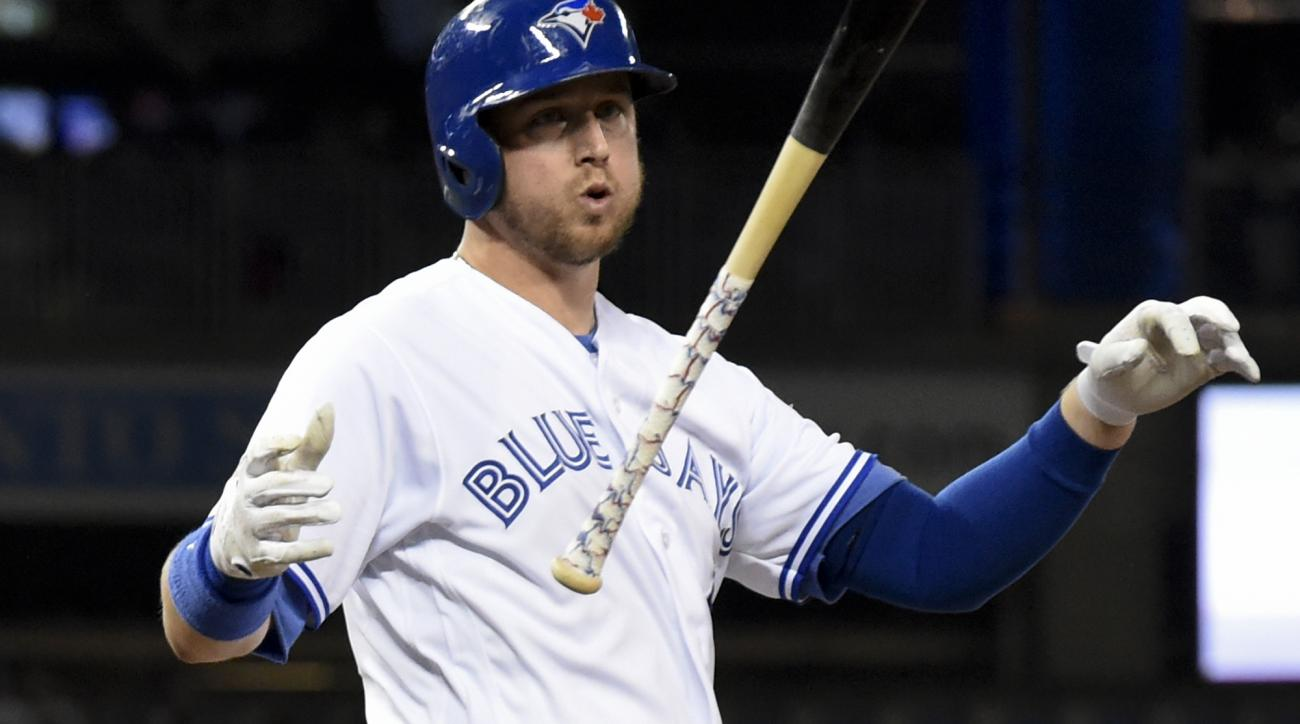 Toronto Blue Jays' Justin Smoak reacts after striking out against the Cleveland Indians during the seventh inning in Game 3 of baseball's American League Championship Series in Toronto, Monday, Oct. 17, 2016. (Frank Gunn/The Canadian Press via AP)