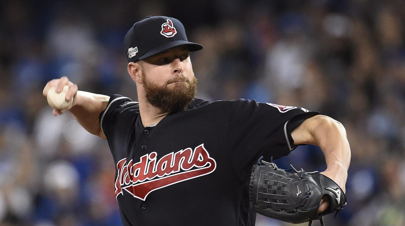 Cleveland Indians pitcher Corey Kluber pitches to the Toronto Blue Jays during first inning in Game 4 of baseball's American League Championship Series in Toronto, Tuesday, Oct. 18, 2016. (AP Photo/The Canadian Press/Nathan Denette)