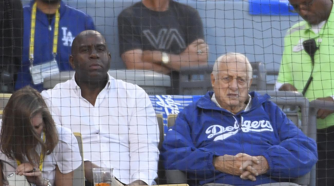 Tommy Lasorda and Magic Johnson watch during the first inning of Game 3 of the National League baseball championship series against the Chicago Cubs Tuesday, Oct. 18, 2016, in Los Angeles. (AP Photo/Mark J. Terrill)