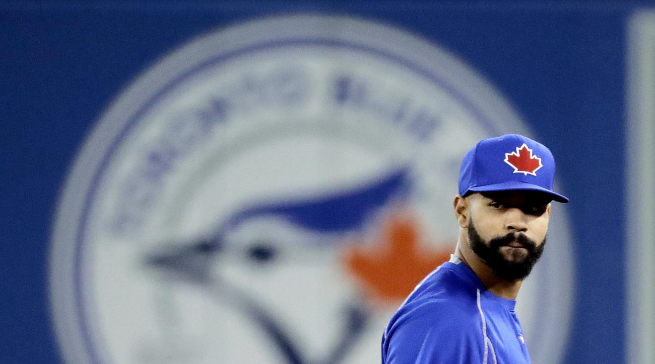 CORRECTS DATE TO OCT. 19, NOT OCT. 18 -Toronto Blue Jays right fielder Jose Bautista watches during batting practice before Game 5 of baseball's American League Championship Series against the Cleveland Indians in Toronto, Wednesday, Oct. 19, 2016. (AP Ph