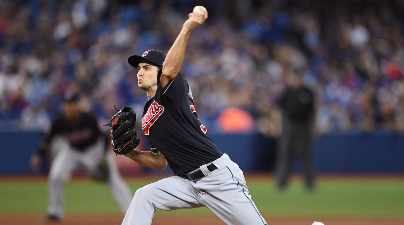 Cleveland Indians starting pitcher Ryan Merritt pitches against the Toronto Blue Jays during the first inning in Game 5 of baseball's American League Championship Series  in Toronto, Wednesday, Oct. 19, 2016.  (Mark Blinch/The Canadian Press via AP)