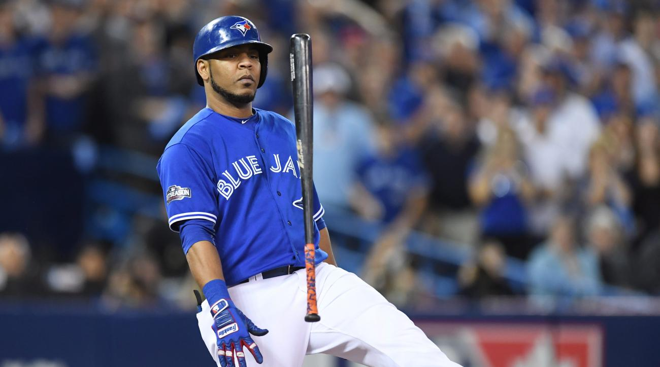 Toronto Blue Jays' Edwin Encarnacion flips his bat after a foul ball against the Cleveland Indians during fourth inning in Game 5 of baseball's American League Championship Series in Toronto, Wednesday, Oct. 19, 2016. (Frank Gunn/The Canadian Press via AP
