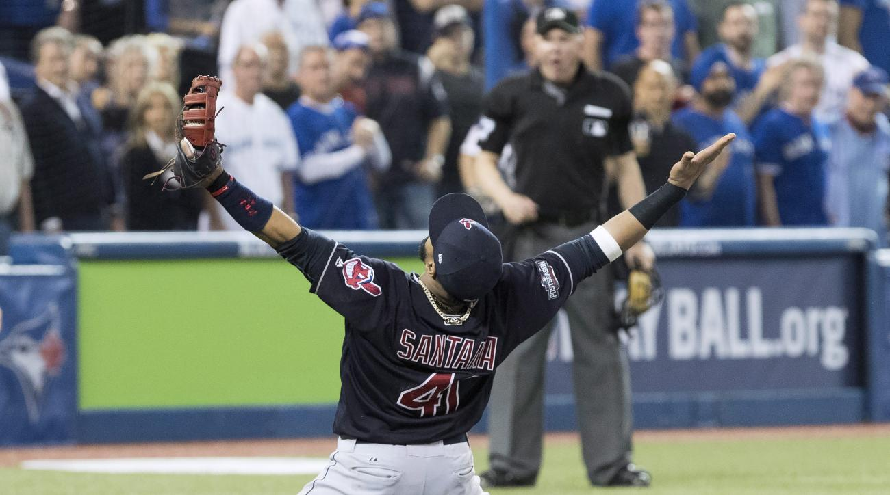 Cleveland Indians first baseman Carlos Santana celebrates after the Indians defeated the Toronto Blue Jays 3-0 in Game 5 of the baseball American League Championship Series in Toronto on Wednesday, Oct. 19, 2016. (Mark Blinch/The Canadian Press via AP)