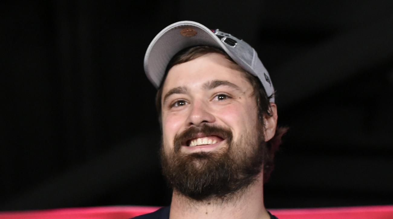 Cleveland Indians relief pitcher Andrew Miller accepts the MVP trophy for the series after the Indians defeated the Toronto Blue Jays 3-0 in Game 5 of the baseball American League Championship Series in Toronto on Wednesday, Oct. 19, 2016. (Nathan Denette