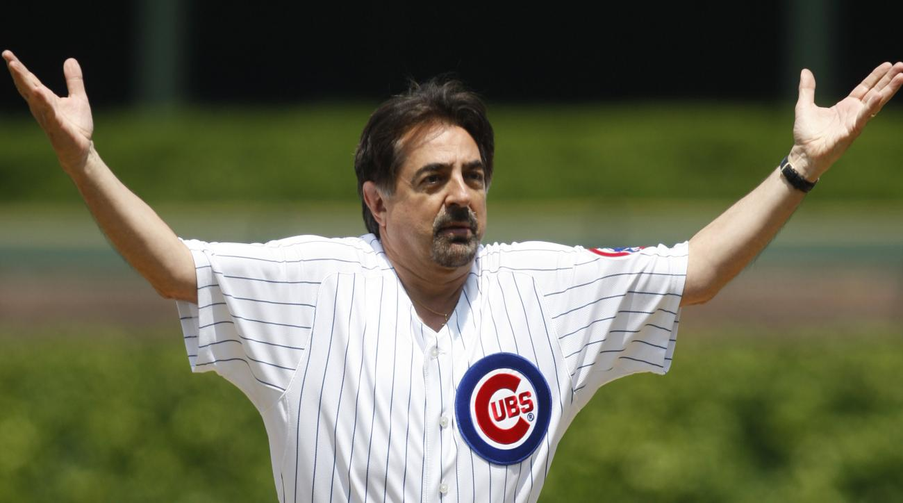 FILE - In this May 29, 2009 file photo, actor Joe Mantegna reacts after throwing out the ceremonial first pitch before the start of a baseball game between the Los Angeles Dodgers and the Chicago Cubs, in Chicago. The Chicago Cubs are trying to do somethi