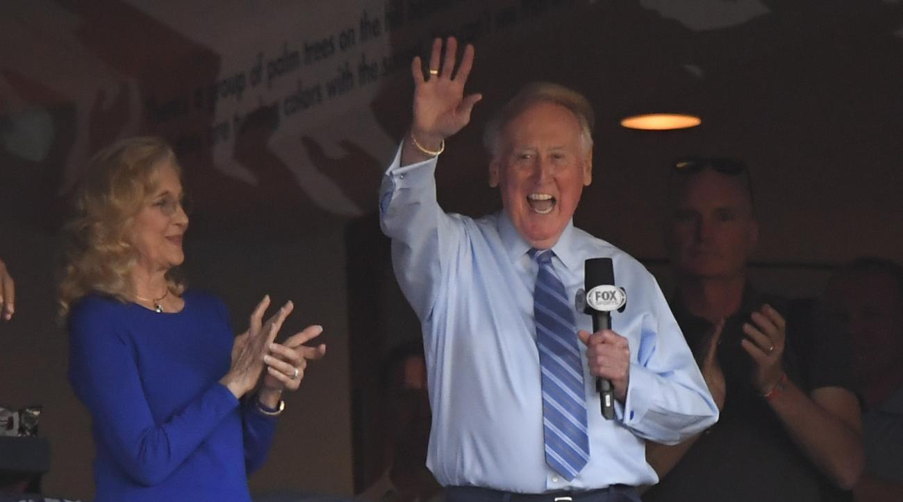 Vin Scully acknowledges the crowd from a box before Game 5 of the National League baseball championship series between the Chicago Cubs and the Los Angeles Dodgers Thursday, Oct. 20, 2016, in Los Angeles. (AP Photo/Mark J. Terrill)