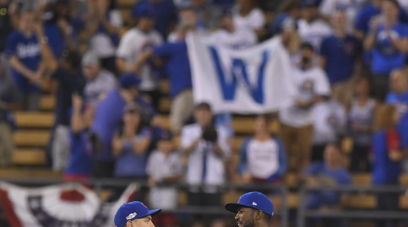 Chicago Cubs' Albert Almora Jr. and Dexter Fowler celebrate after Game 5 of the National League baseball championship series against the Los Angeles Dodgers Thursday, Oct. 20, 2016, in Los Angeles. The Cubs won 8-4 to take a 3-2 lead in the series. (AP Ph