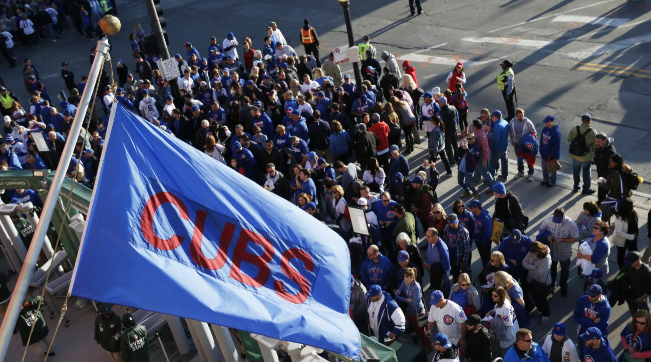 Fans wait outside Wrigley Field before Game 6 of the National League baseball championship series between the Chicago Cubs and the Los Angeles Dodgers, Saturday, Oct. 22, 2016, in Chicago. (AP Photo/Nam Y. Huh)