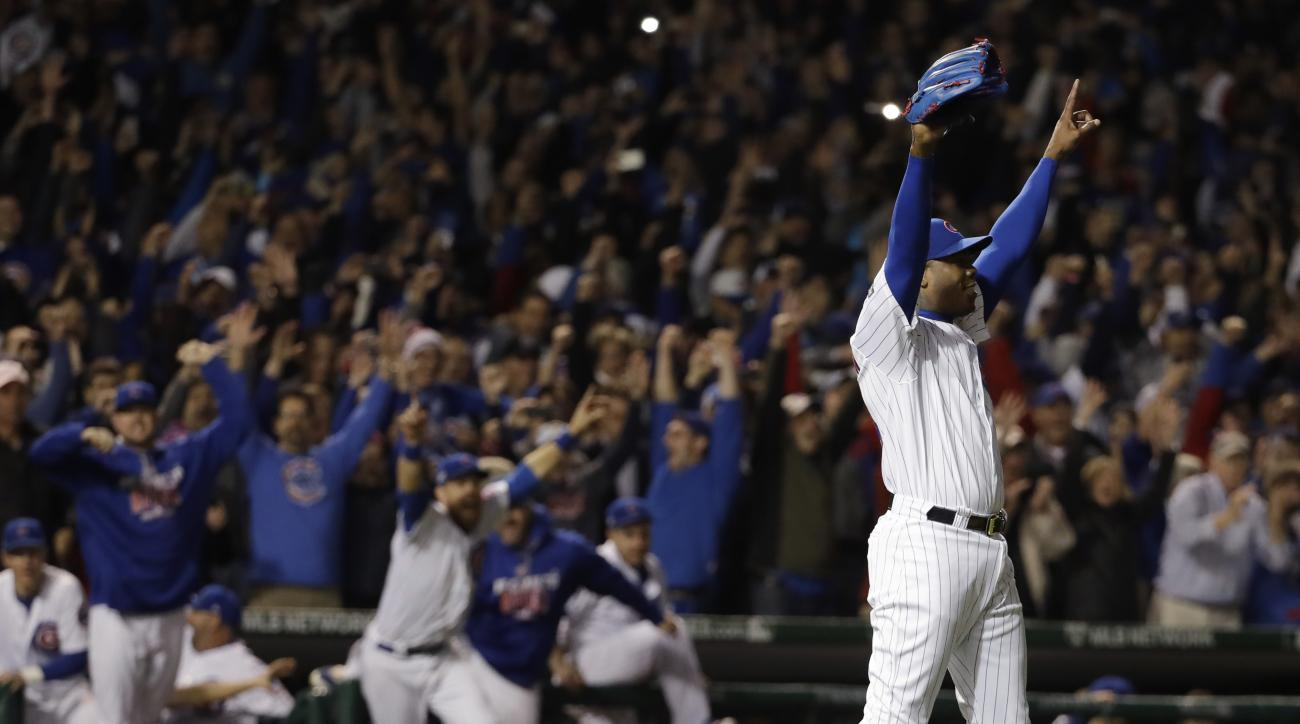 Chicago Cubs relief pitcher Aroldis Chapman (54) celebrates after Game 6 of the National League baseball championship series against the Los Angeles Dodgers, Saturday, Oct. 22, 2016, in Chicago. The Cubs won 5-0 to win the series and advance to the World