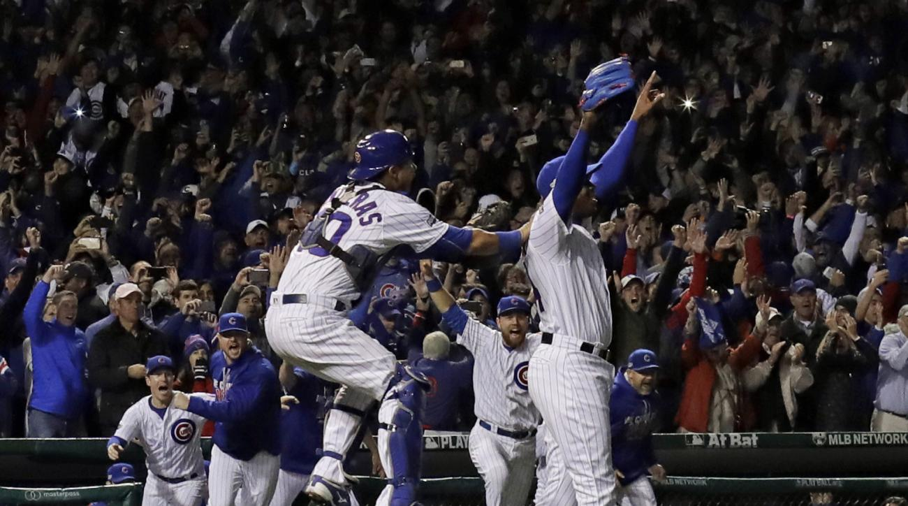 Chicago Cubs relief pitcher Aroldis Chapman (54) and catcher Willson Contreras (40) celebrate after Game 6 of the National League baseball championship series against the Los Angeles Dodgers, Saturday, Oct. 22, 2016, in Chicago. The Cubs won 5-0 to win th