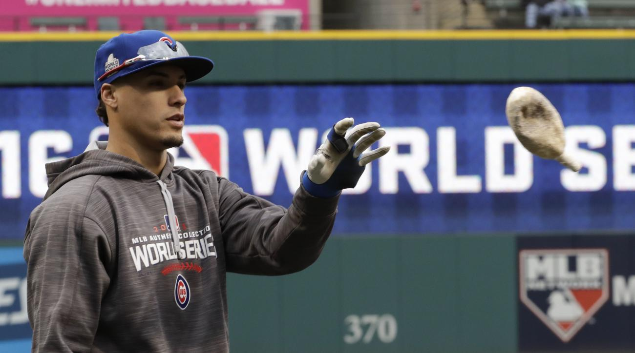 Chicago Cubs third baseman Javier Baez warms up during a team practice for baseball's upcoming World Series against the Cleveland Indians on Monday, Oct. 24, 2016 in Cleveland. (AP Photo/David J. Phillip)