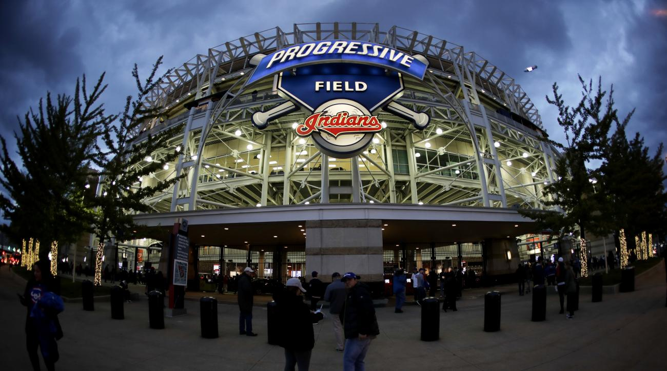 Fans arrive for Game 1 of the Major League Baseball World Series at Progressive Field between the Cleveland Indians and the Chicago Cubs Tuesday, Oct. 25, 2016, in Cleveland. (AP Photo/Charlie Riedel)