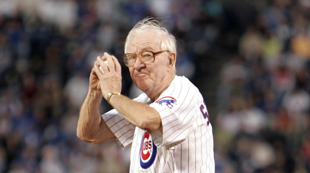 FILE - In this Sept. 14, 2005, file photo, U.S. Supreme Court Justice John Paul Stevens winds up to throw out the first pitch before the start of the Chicago Cubs game with the Cincinnati Reds,  at Wrigley Field in Chicago. John Paul Stevens has rooted fo