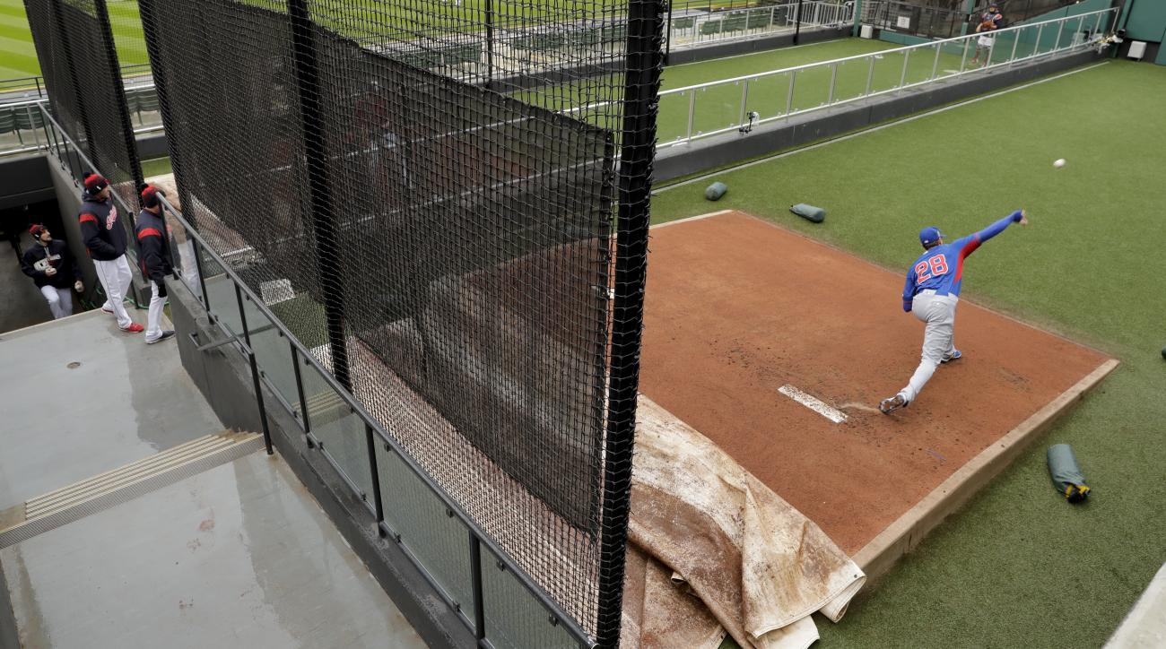 Chicago Cubs starting pitcher Kyle Hendricks throws in the bullpen before Game 2 of the Major League Baseball World Series against the Cleveland Indians Wednesday, Oct. 26, 2016, in Cleveland. (AP Photo/Charlie Riedel)