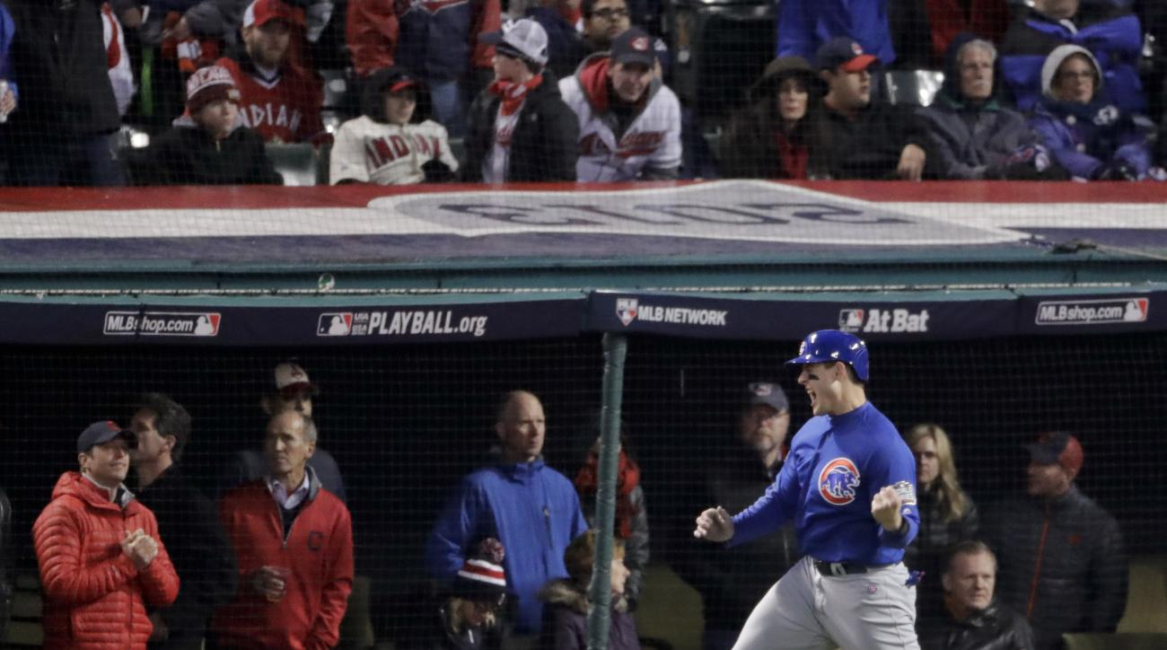 Chicago Cubs' Anthony Rizzo celebrates after scoring on a hit by Ben Zobrist during the fifth inning of Game 2 of the Major League Baseball World Series against the Cleveland Indians Wednesday, Oct. 26, 2016, in Cleveland. (AP Photo/Charlie Riedel)