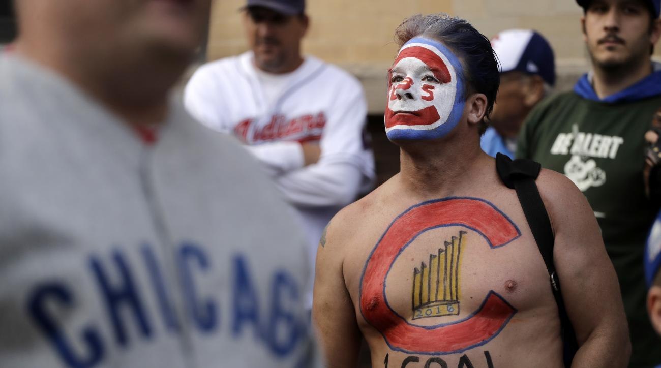 Jason Gilley from Kansas waits for batting practice home run balls on the street outside Wrigley Field before Game 3 of the Major League Baseball World Series between the Chicago Cubs and the Cleveland Indians, Friday, Oct. 28, 2016, in Chicago. (AP Photo