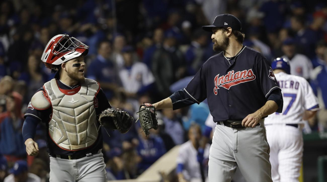 Cleveland Indians catcher Roberto Perez congratulates relief pitcher Andrew Miller after getting Chicago Cubs' Miguel Montero to fly out during the fifth inning of Game 3 of the Major League Baseball World Series Friday, Oct. 28, 2016, in Chicago. (AP Pho