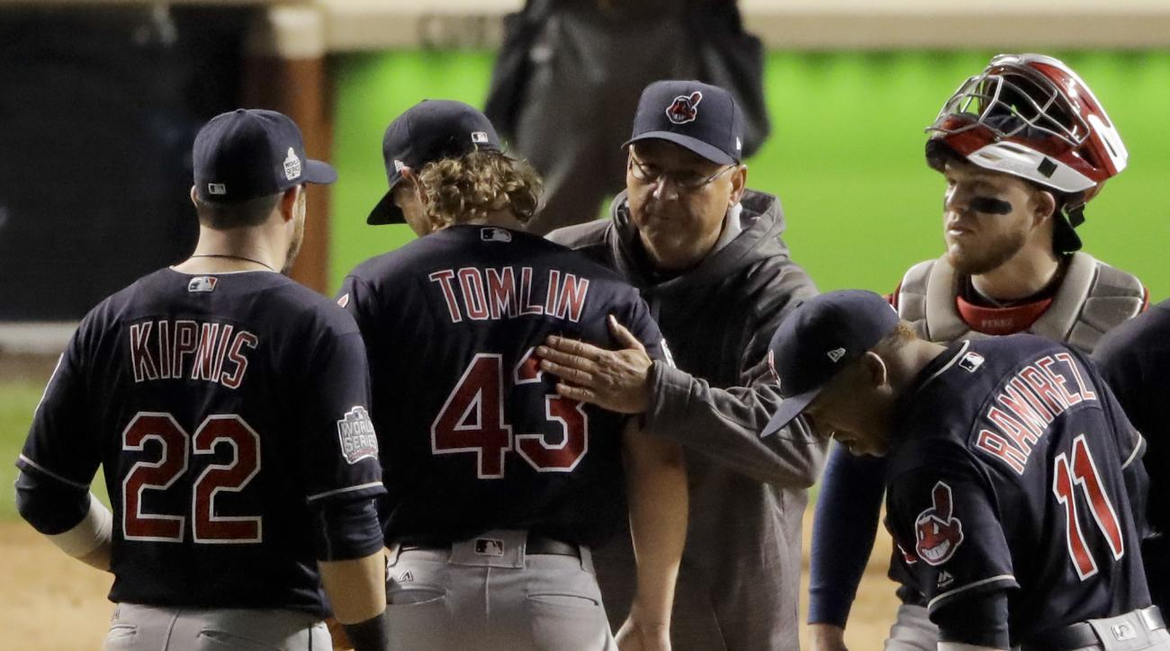 Cleveland Indians starting pitcher Josh Tomlin gets a hug from manager Terry Francona after being taken out of the game during the fifth inning of Game 3 of the Major League Baseball World Series against the Chicago Cubs Friday, Oct. 28, 2016, in Chicago.