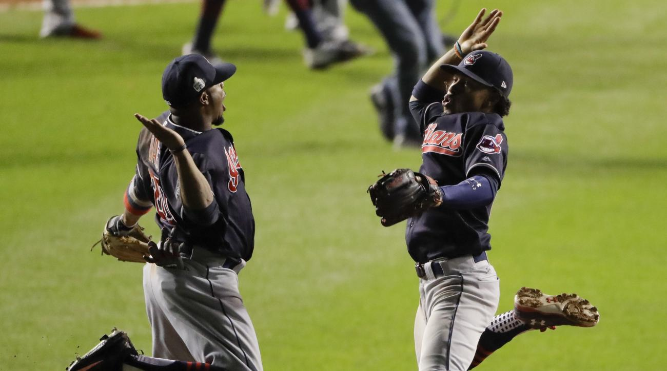 Cleveland Indians shortstop Francisco Lindor, right, and center fielder Rajai Davis celebrate after their win in Game 3 of the Major League Baseball World Series against the Chicago Cubs Friday, Oct. 28, 2016, in Chicago. The Indians won 1-0 to take a 2-1
