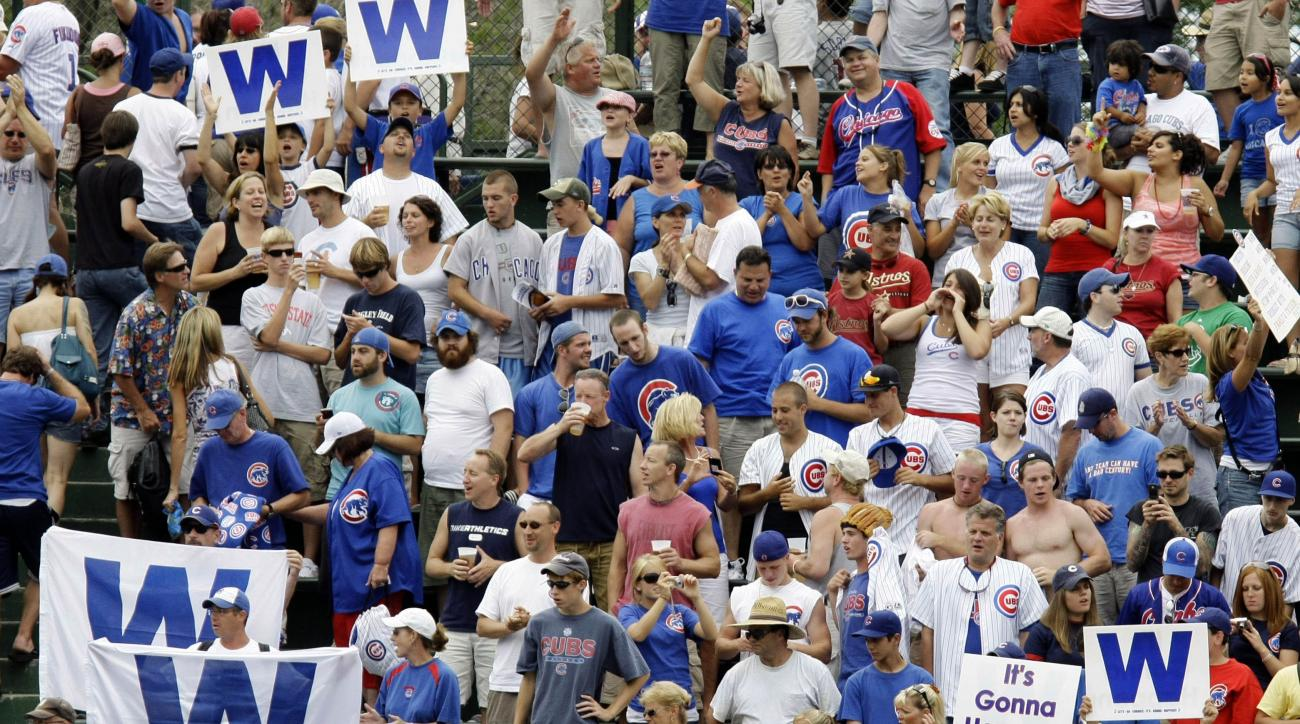 In this Aug. 6, 2008, file photo, Chicago Cubs fans celebrate an 11-4 win over the Houston Astros after a baseball game at Wrigley Field in Chicago. What happens when a lovable loser is no longer a loser? If the Cubs win the World Series for the first tim
