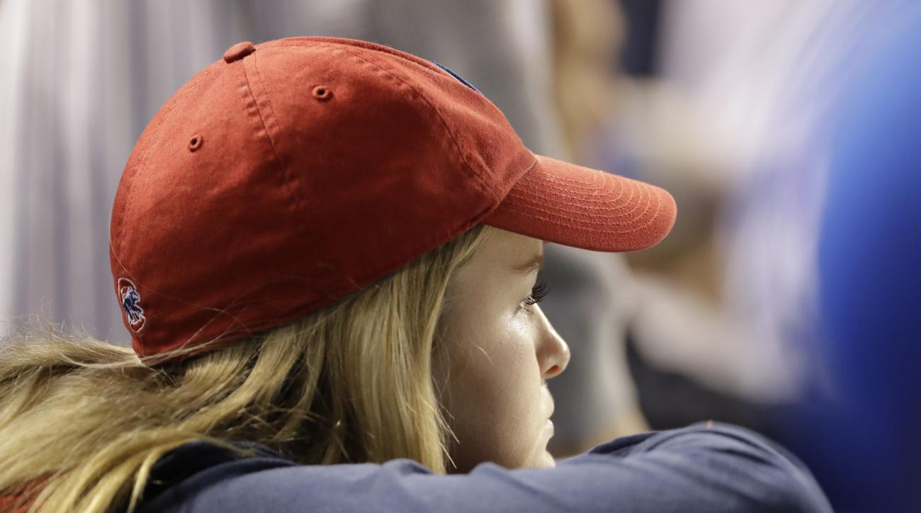 A Chicago Cubs fan watches during the ninth inning of Game 4 of the Major League Baseball World Series against the Cleveland Indians Saturday, Oct. 29, 2016, in Chicago. (AP Photo/David J. Phillip)