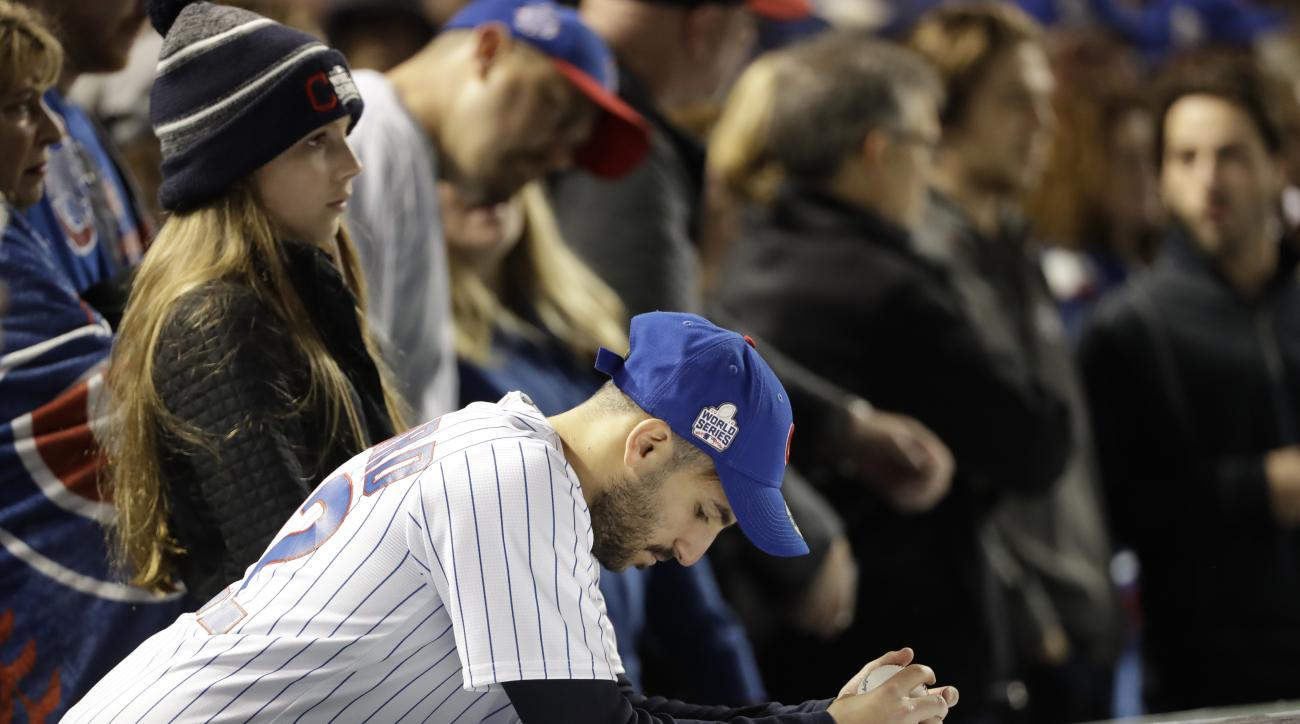 Chicago Cubs fans watch during the ninth inning of Game 4 of the Major League Baseball World Series against the Cleveland Indians Saturday, Oct. 29, 2016, in Chicago. (AP Photo/David J. Phillip)