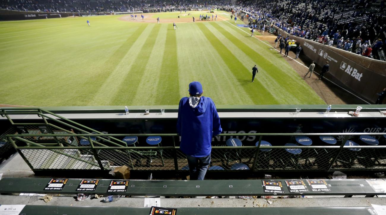A Chicago Cubs fans watches in the stands after Game 4 of the Major League Baseball World Series against the Cleveland Indians Saturday, Oct. 29, 2016, in Chicago. The Indians won 7-2 to take a 3-1 lead in the series. (AP Photo/Charles Rex Arbogast)