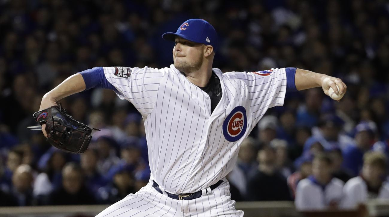 Chicago Cubs starting pitcher Jon Lester throws during the first inning of Game 5 of the Major League Baseball World Series against the Cleveland Indians Sunday, Oct. 30, 2016, in Chicago. (AP Photo/David J. Phillip)