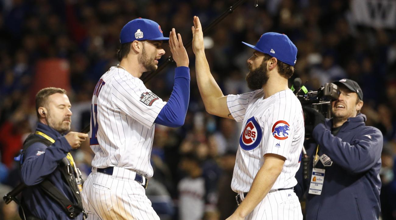 Chicago Cubs' Kris Bryant, left, celebrates with Jake Arrieta after Game 5 of the Major League Baseball World Series against the Cleveland Indians, Sunday, Oct. 30, 2016, in Chicago. The Cubs won 3-2 as the Indians lead the series 3-2. (AP Photo/Nam Y. Hu