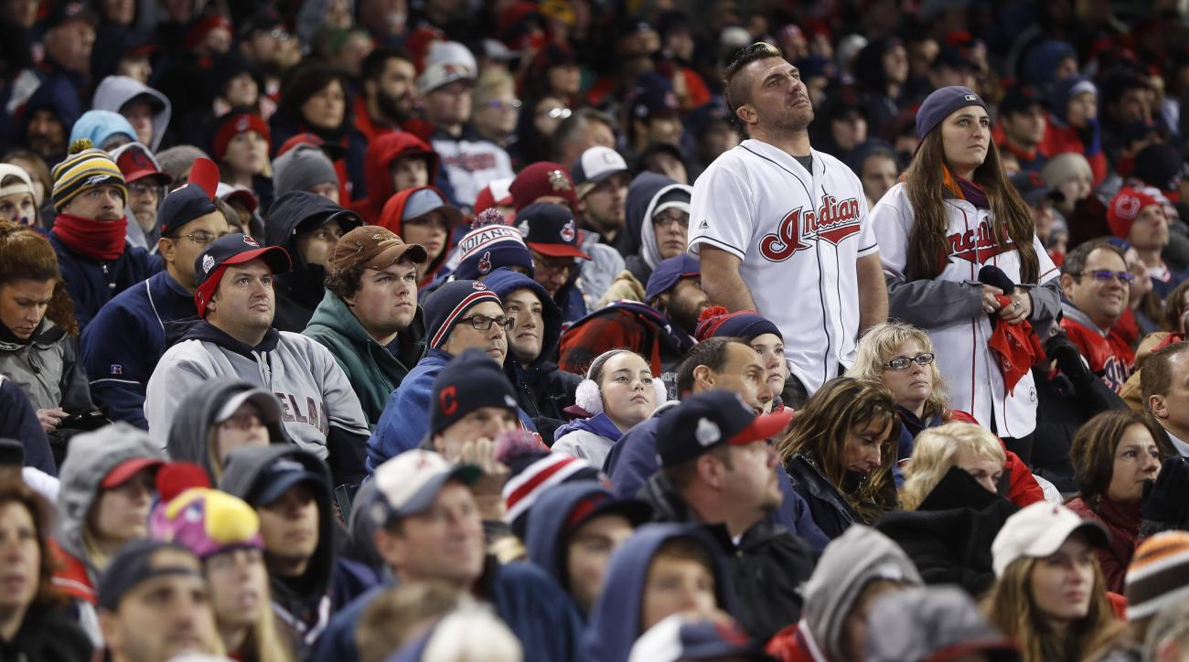 Cleveland Indians fans stand in silence during a Game 5 watch party of the Major League Baseball World Series against the Chicago Cubs at Progressive Field, Sunday, Oct. 30, 2016, in Cleveland. The Cubs won 3-2. (AP Photo/John Minchillo)