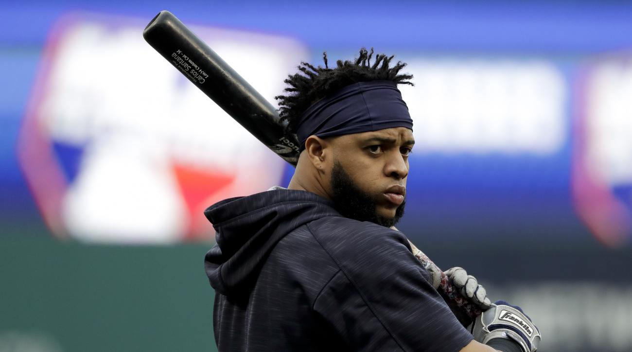 Cleveland Indians first baseman Carlos Santana watches during batting practice before Game 6 of the Major League Baseball World Series Tuesday, Nov. 1, 2016, in Cleveland. (AP Photo/Matt Slocum)