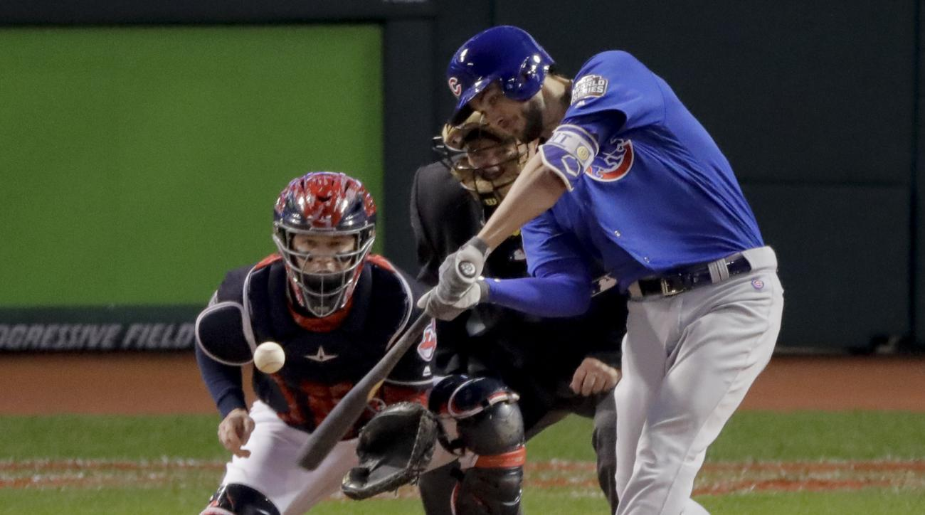 Chicago Cubs' Kris Bryant hits a home run against the Cleveland Indians during the first inning of Game 6 of the Major League Baseball World Series Tuesday, Nov. 1, 2016, in Cleveland. (AP Photo/Charlie Riedel)