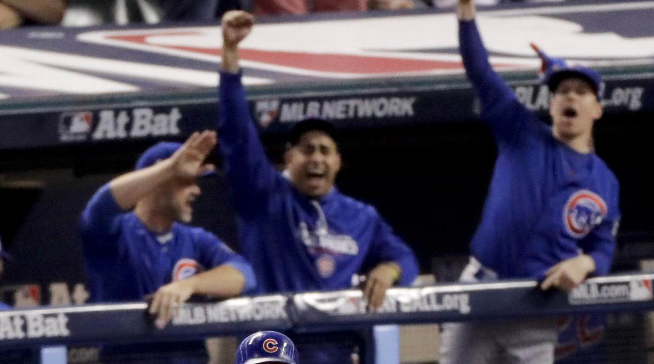 Chicago Cubs' Addison Russell celebrates after his grand slam against the Cleveland Indians during the third inning of Game 6 of the Major League Baseball World Series Tuesday, Nov. 1, 2016, in Cleveland. (AP Photo/Charlie Riedel)