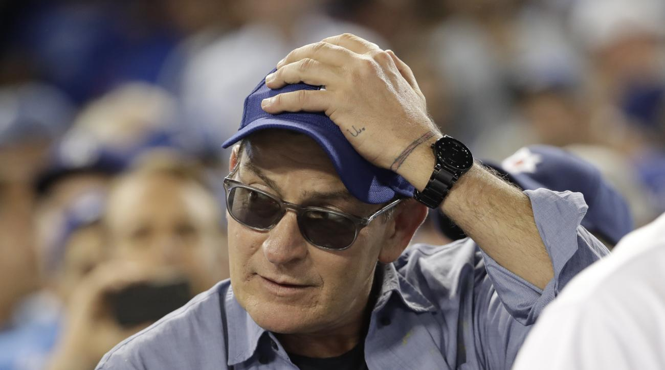"FILE - In this Oct. 19, 2016, file photo, actor Charlie Sheen reacts during the fifth inning of Game 4 of the National League baseball championship series between the Chicago Cubs and the Los Angeles Dodgers in Los Angeles. Sheen, who played Ricky ""Wild T"