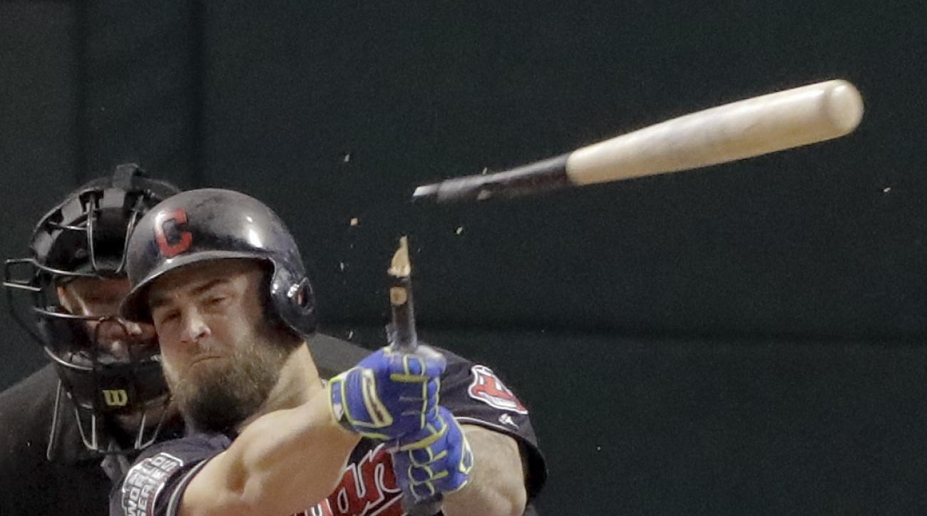 Cleveland Indians' Mike Napoli breaks his bat and grounds out against the Chicago Cubs during the first inning of Game 7 of the Major League Baseball World Series Wednesday, Nov. 2, 2016, in Cleveland. (AP Photo/Charlie Riedel)