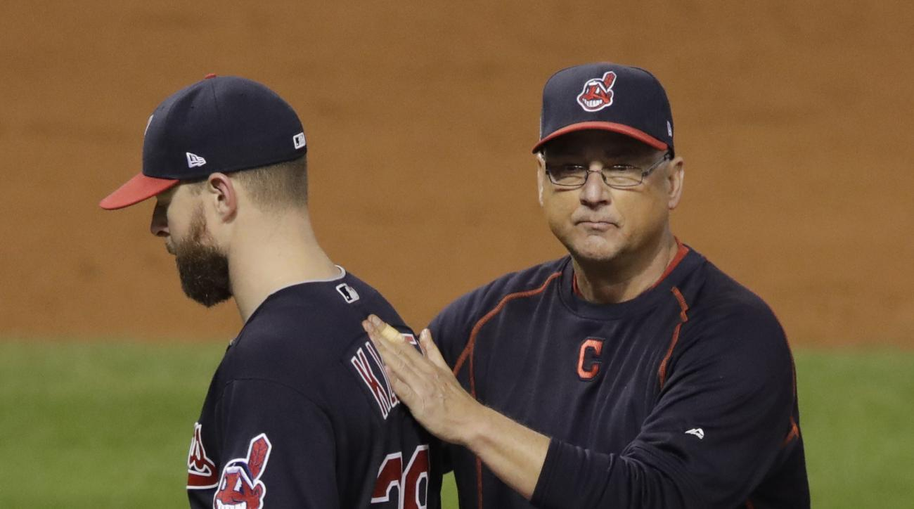 Cleveland Indians manager Terry Francona takes starting pitcher Corey Kluber out of the game during the fifth inning of Game 7 of the Major League Baseball World Series against the Chicago Cubs Wednesday, Nov. 2, 2016, in Cleveland. (AP Photo/Gene J. Pusk