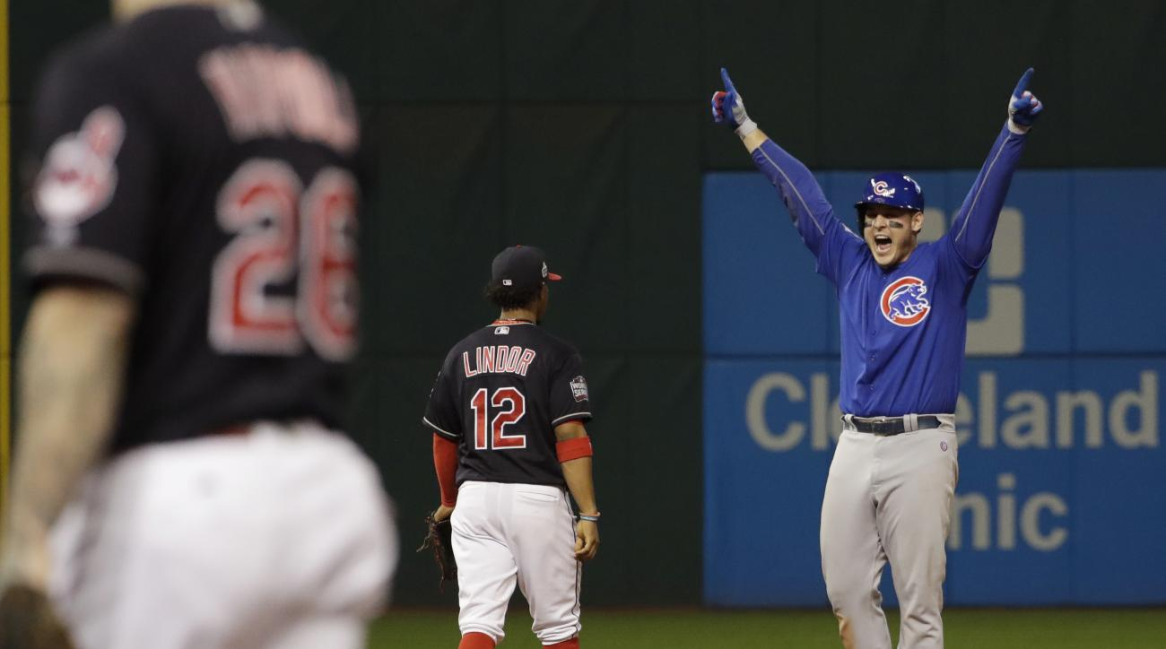 Chicago Cubs' Anthony Rizzo reacts after teammate Kris Bryant scored on Rizzo's hit during the fifth inning of Game 7 of the Major League Baseball World Series against the Cleveland Indians Wednesday, Nov. 2, 2016, in Cleveland. (AP Photo/David J. Phillip