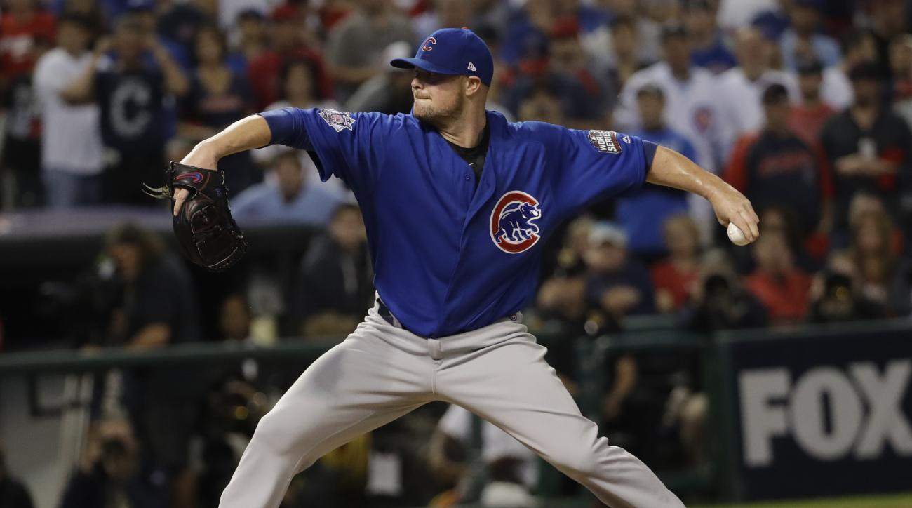 Chicago Cubs pitcher Jon Lester throws during the fifth inning of Game 7 of the Major League Baseball World Series against the Cleveland Indians Wednesday, Nov. 2, 2016, in Cleveland. (AP Photo/David J. Phillip)