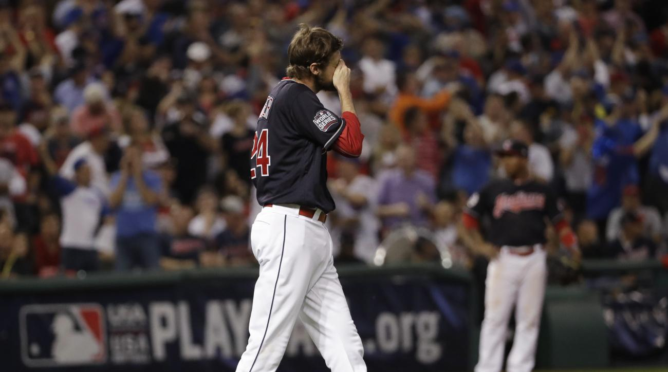 Cleveland Indians relief pitcher Andrew Miller reacts after giving up a home run to Chicago Cubs' David Ross during the sixth inning of Game 7 of the Major League Baseball World Series Wednesday, Nov. 2, 2016, in Cleveland. (AP Photo/David J. Phillip)