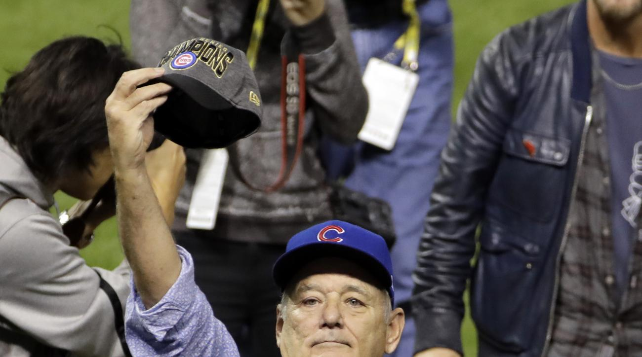 Bill Murray celebrates after Game 7 of the Major League Baseball World Series between the Cleveland Indians and the Chicago Cubs Thursday, Nov. 3, 2016, in Cleveland. The Cubs won 8-7 in 10 innings to win the series 4-3. (AP Photo/Gene J. Puskar)